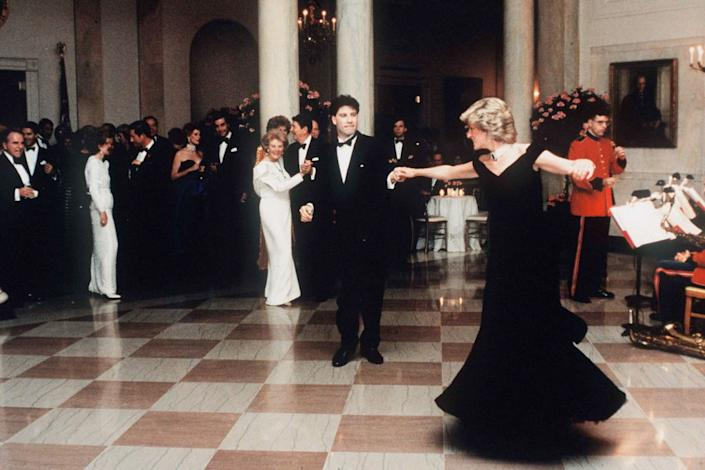 """Diana, Princess Of Wales dancing with John Travolta at the White House, Washington, on Nov. 9, 1985. The princess wore a midnight blue velvet dress by fashion designer Victor Edelstein, as President Ronald and Mrs Nancy Reagan watched on<span class=""""copyright"""">Tim Graham Photo Library via Getty Images</span>"""