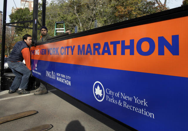 Workers assemble the finish line for the New York City Marathon in New York's Central Park, Thursday, Nov. 1, 2012. The New York City Marathon is on Sunday, with many logistical questions to be answered. (AP Photo/Richard Drew)