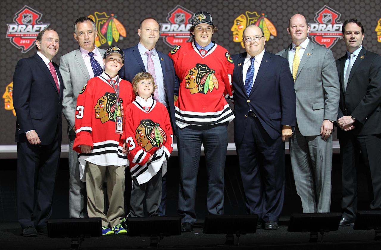 Jun 30, 2013; Newark, NJ, USA; Ryan Hartman poses for a photo after being introduced as the number thirty overall pick to the Chicago Blackhawks during the 2013 NHL Draft at the Prudential Center. (Ed Mulholland-USA TODAY Sports)