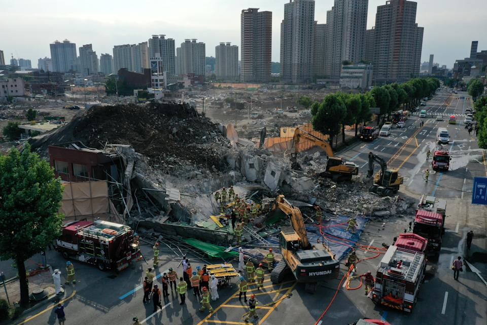 The building fell onto a busy road in the city, South Korea. Source: Reuters