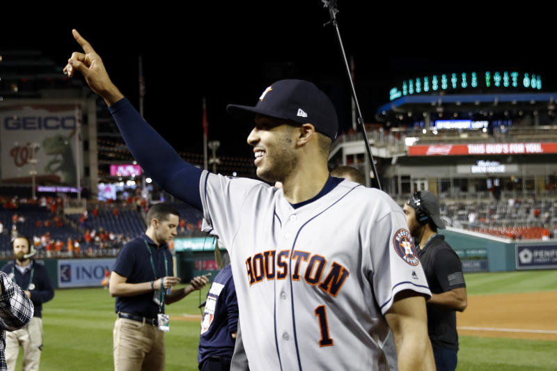 Houston Astros shortstop Carlos Correa walks off the field after Game 5 of the baseball World Series Washington Nationals Sunday, Oct. 27, 2019, in Washington. The Astros won 7-1 to take a 3-2 lead in the series. (AP Photo/Patrick Semansky)