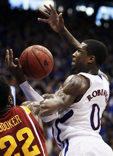 Iowa State forward Anthony Booker (22) fouls Kansas forward Thomas Robinson (0) during the first half of an NCAA college basketball game in Lawrence, Kan., Saturday, Jan. 14, 2012. (AP Photo/Orlin Wagner)