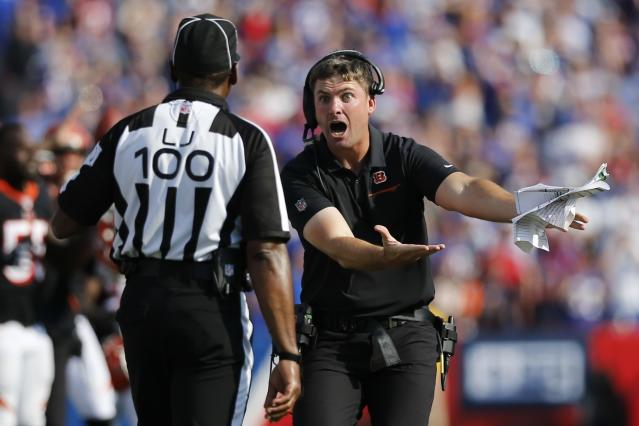 FILE - In this Sept. 22, 2019, file photo, Cincinnati Bengals head coach Zac Taylor argues for a call during the second half of an NFL football game against the Buffalo Bills, in Orchard Park, N.Y. Several teams are tanking, penalties are wrecking the flow of games, some of the biggest stars have been sidelined, the new pass interference rule appears to have been adapted only to quiet the uproar that started after last season's NFC Championship game, and even though ratings are up, it all looks like one big mess on TV. (AP Photo/John Munson, File)