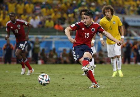 Colombia's James Rodriguez scores a penalty shot during the 2014 World Cup quarter-finals between Brazil and Colombia at the Castelao arena