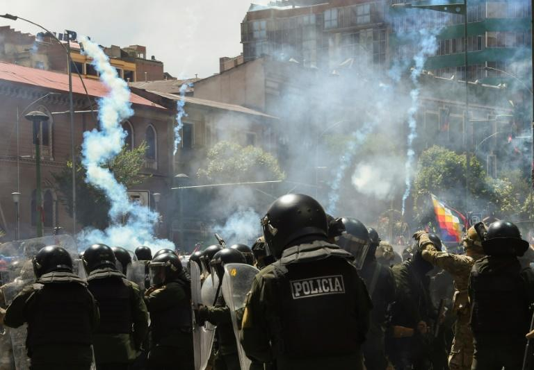 Riot police fire tear gas at supporters of former Bolivian president Evo Morales in La Paz on November 21, 2019