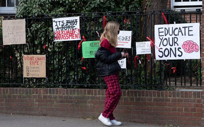 Protest signs are seen on railings at James Allen's Girls' School in Dulwich, London - Eddie Mulholland