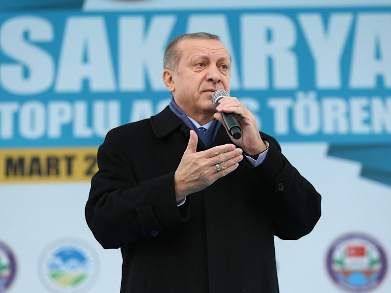 Mr Erdogan said the EU could 'forget about' the migrant deal: EPA