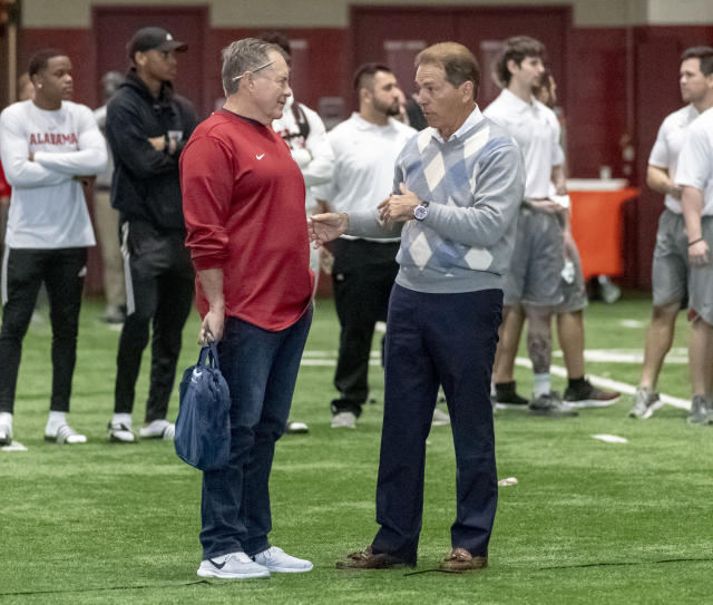 """A documentary about the relationship between <a class=""""link rapid-noclick-resp"""" href=""""/nfl/teams/new-england/"""" data-ylk=""""slk:New England Patriots"""">New England Patriots</a> head coach Bill Belichick and Alabama head coach Nick Saban will air on HBO in December. (AP Photo/Vasha Hunt)"""