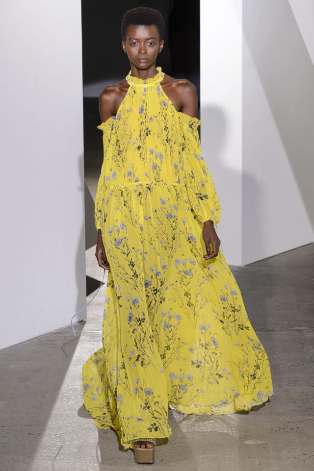 <p><i>Model wears a high-neck, exposed-shoulder, yellow floral dress from the SS18 Self-Portrait collection. (Photo: ImaxTree) </i></p>