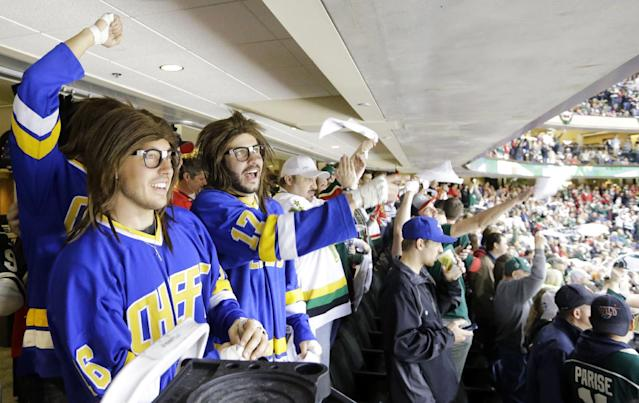 Fans dressed as the Hanson Brothers from the movie Slap Shot cheer with other fans during the final minutes of the third period of Game 4 of an NHL hockey second-round playoff series between the Minnesota Wild and the Chicago Blackhawks in St. Paul, Minn., Friday, May 9, 2014. The Wild won 4-2. (AP Photo/Ann Heisenfelt)