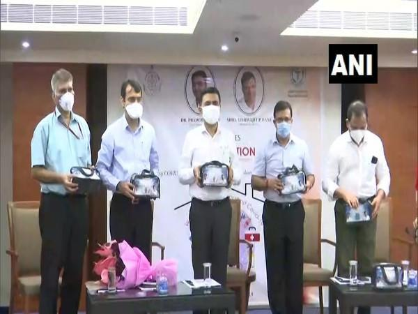 Goa Chief Minister Pramod Sawant (in the middle) launching 'home isolation kit' with Health Minister Vishwajit Rane (Right to Sawant) and other officials. (Photo/ANI)