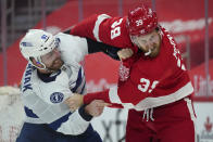 Tampa Bay Lightning defenseman Erik Cernak (81) and Detroit Red Wings right wing Anthony Mantha (39) fight in the second period of an NHL hockey game Tuesday, March 9, 2021, in Detroit. (AP Photo/Paul Sancya)