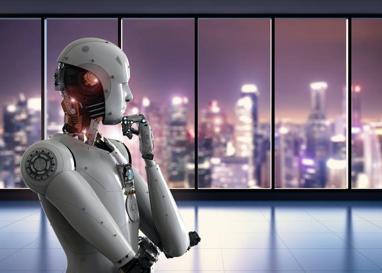 Picture of a robot looking out the window.