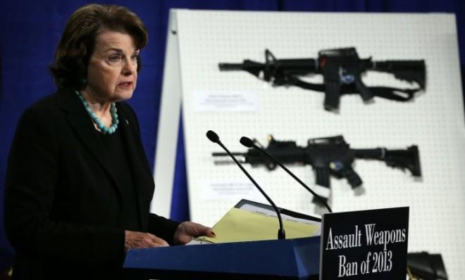 Sen. Dianne Feinstein speaks in front of a display of assault weapons during a news conference on Jan. 24.