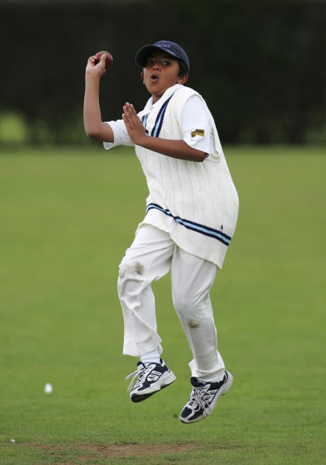 LONDON - AUGUST 14: A young cricketer bowls at The Spencer Club on August 14, 2005 in London. (Photo by Clive Rose/Getty Images)