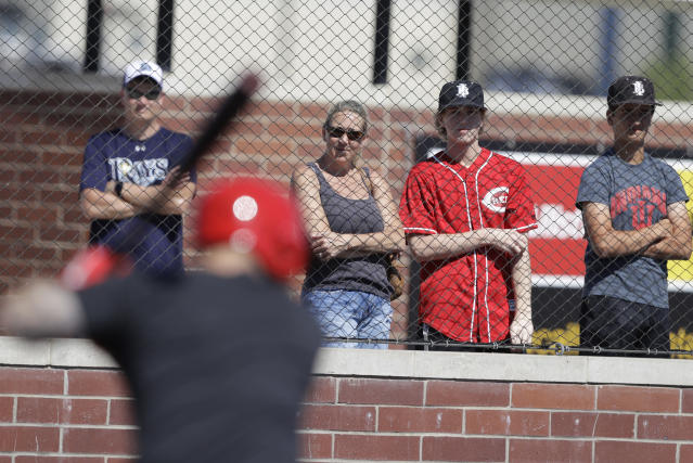Fans watch as Cincinnati Reds catcher Tucker Barnhart takes batting practice during a workout at Grand Park, Friday, June 12, 2020, in Westfield, Ind. Proceeds from the event will go to Reviving Baseball in the Inner City of Indianapolis. (AP Photo/Darron Cummings)