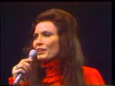 """<p>Loretta's voice sounds so pure in this patriotic hymn. Conway joins her about halfway through the song with some spoken words.</p><p><a href=""""https://www.youtube.com/watch?v=hQeI7kb-mnY"""" rel=""""nofollow noopener"""" target=""""_blank"""" data-ylk=""""slk:See the original post on Youtube"""" class=""""link rapid-noclick-resp"""">See the original post on Youtube</a></p>"""