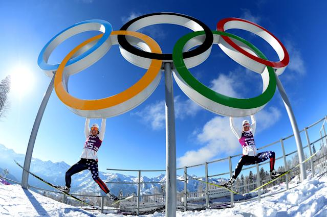 SOCHI, RUSSIA - FEBRUARY 05: Cross-country skiers Sophie Caldwell (L) and Sadie Bjornsen of the United States hang from the Olympic rings ahead of the Sochi 2014 Winter Olympics at the Laura Cross-Country Ski and Biathlon Center on February 5, 2014 in Sochi, Russia. (Photo by Harry How/Getty Images)