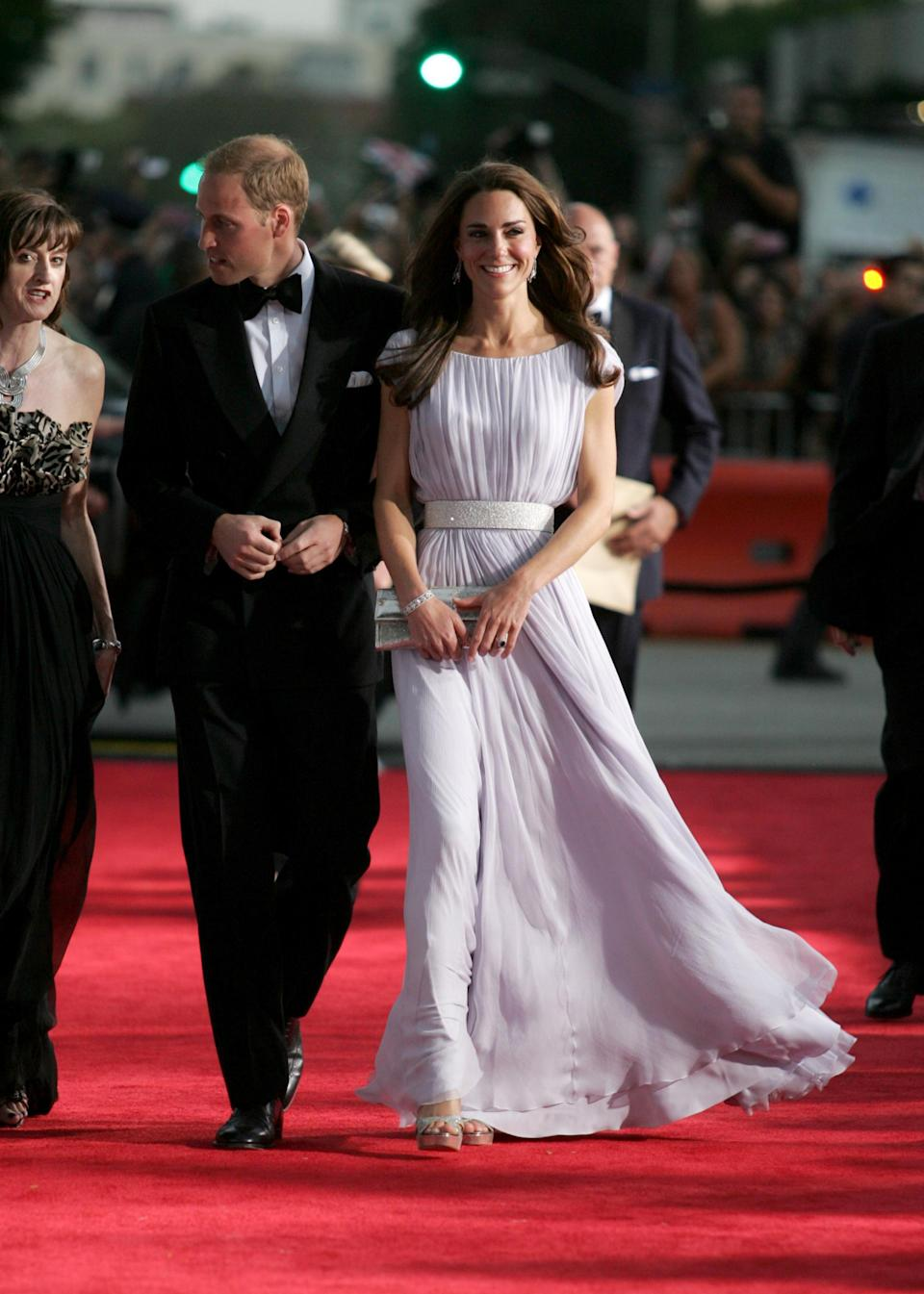 <p>The Duchess of Cambridge looked to go-to label Alexander McQueen for sartorial assistance back in 2011 while Prince William opted for a traditional tux. <em>[Photo: Getty]</em> </p>