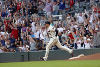 Fans react as Atlanta Braves' Freddie Freeman rounds the bases after hitting a two-run homer in the sixth inning of a baseball game against the Chicago White Sox Sunday, Sept. 1, 2019, in Atlanta. It was Freeman's second two-run home run of the game. (AP Photo/John Bazemore)