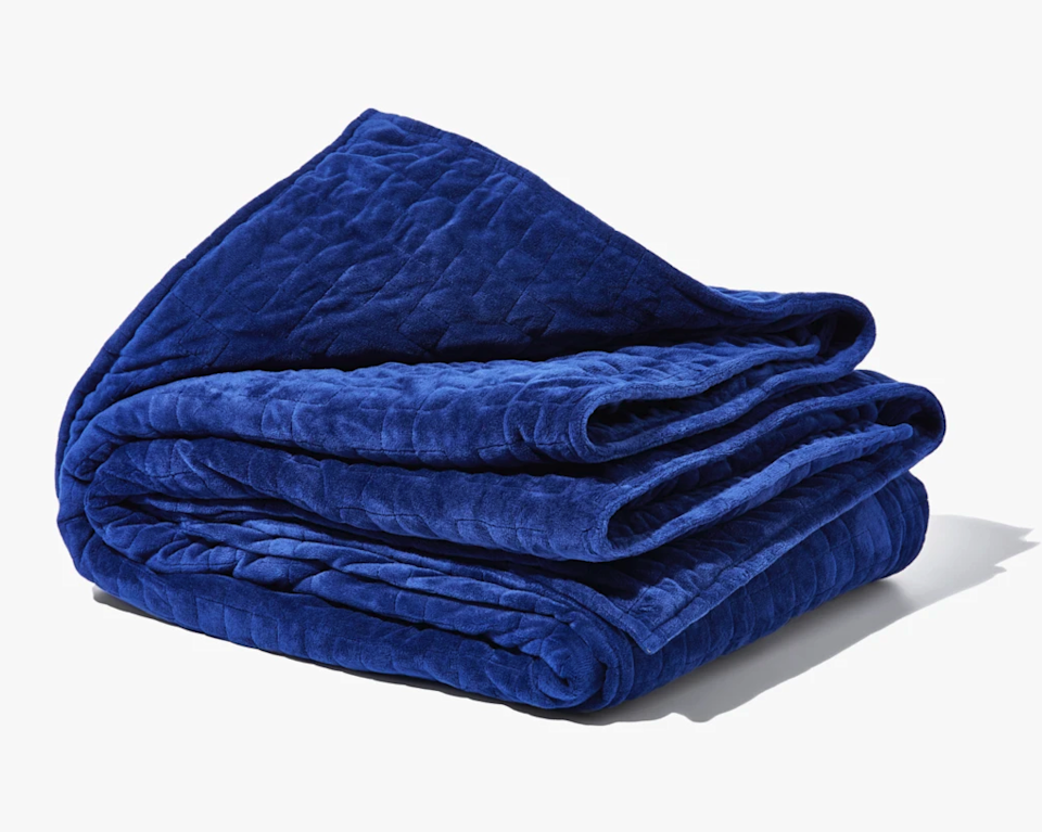 """<h3>Gravity Blanket</h3><br><span>Dubbed """"The World's Most Popular Weighted Blanket</span>,"""" Gravity's fine-grade glass bead-filled style comes complete with a premium microfleece duvet cover and is offered in a weight range of 15 to 20 or 25 pounds. <br><br><strong>The hype:</strong> 4.6 out of 5 stars and 2069 reviews on <a href=""""https://gravityblankets.com"""" rel=""""nofollow noopener"""" target=""""_blank"""" data-ylk=""""slk:Gravity"""" class=""""link rapid-noclick-resp"""">Gravity</a><br><br><strong>What they're saying:</strong> """"This is one of the best purchases I have ever made. I sleep better than ever, and it also helps me from sleeping on my stomach which I have a habit of doing in the middle of the night. It relaxes me and keeps me asleep throughout the night, which I always had an issue with. I have recommended this to sooo many of my friends who have also purchased one and are obsessed as well. I joke around with family and friends that I should really be working for Gravity Blankets at this point because I talk about it more so than anything else :). Thanks for making my life so much better!"""" <em>– Jacqueline, Gravity reviewer </em><br><br><br><strong>Gravity</strong> Gravity Blanket, $, available at <a href=""""https://go.skimresources.com/?id=30283X879131&url=https%3A%2F%2Fgravityblankets.com%2Fproducts%2Fgravity-blanket"""" rel=""""nofollow noopener"""" target=""""_blank"""" data-ylk=""""slk:Gravity Blankets"""" class=""""link rapid-noclick-resp"""">Gravity Blankets</a>"""