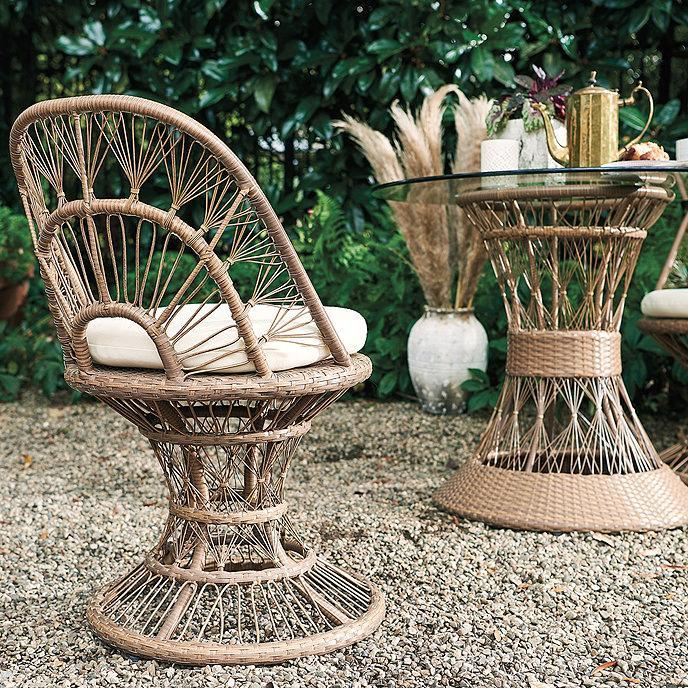 "<p>In the market for a petite, weatherproof lounge chair for your small balcony that still packs plenty of style? Sinclair recommends an eye-catching wicker dining chair or two. ""Whether solo or as a pair, these lightweight wicker chairs are airy and on-trend,"" she says. ""All you need is a glass of wine or cold lemonade to complete the scene.""</p> <p><strong><em>Shop Now: </em></strong><em>Ballard Designs ""Willow"" Dining Chair, $399</em><em>, </em><a href=""https://www.ballarddesigns.com/willow-dining-chair/outdoor/furniture/collection/willow/559973"" rel=""nofollow noopener"" target=""_blank"" data-ylk=""slk:ballarddesigns.com"" class=""link rapid-noclick-resp""><em>ballarddesigns.com</em></a><em>.</em></p>"