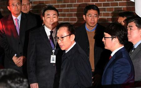 Former South Korean president Lee Myung-bak gets in a car as he is transferred to a detention centre, at his residence in Seoul as he is transferred to a detention centre, at his residence in Seoul, South Korea March 23, 2018. Jung Yeon-je/Pool via Reuters