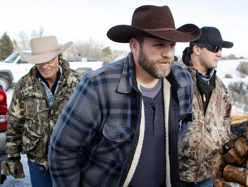 Protest leader Ammon Bundy (C) repeated a call for the last four holdouts to peacefully leave the Malheur National Wildlife Refuge to avoid more bloodshed (AFP Photo/Rob Kerr)