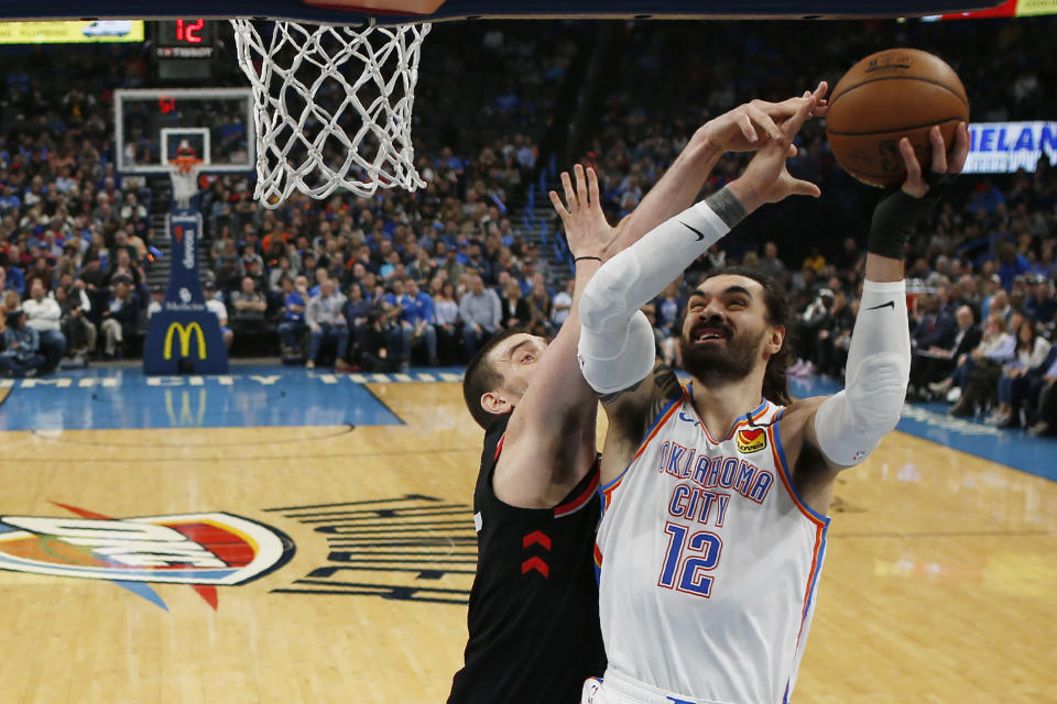 Oklahoma City Thunder center Steven Adams (12) goes to the basket in front of Toronto Raptors center Marc Gasol, left, during the first half of an NBA basketball game Wednesday, Jan. 15, 2020, in Oklahoma City. (AP Photo/Sue Ogrocki)