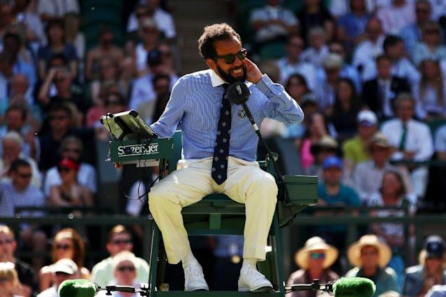"""Chair umpire Kader Nouni swats flying ants during the second round match between <a class=""""link rapid-noclick-resp"""" href=""""/olympics/rio-2016/a/1211274/"""" data-ylk=""""slk:Johanna Konta"""">Johanna Konta</a> of Great Britain and Donna Vekic of Croatia. (Getty Images)"""
