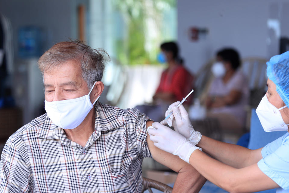 A man receives a shot of the Moderna COVID-19 vaccine in Vung Tau, Vietnam, Monday, Sep. 13, 2021. Vietnam is speeding up its vaccination program in an effort to loosen coronavirus lockdown restrictions in major cities by the end of September, the government said. (AP Photo/Hau Dinh)