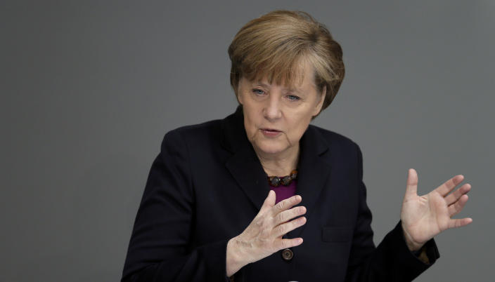 German Chancellor Angela Merkel gestures during a statement at the German parliament Bundestag, in Berlin, Thursday, March 20, 2014. Russia faces further sanctions from the European Union on Thursday over its annexation of the Crimea Peninsula as tensions in the region remained high despite the release of a Ukrainian naval commander. In an address to the German Parliament, Chancellor Angela Merkel said the EU was readying further sanctions and that the G-8 forum of leading economies had been suspended indefinitely. Russia holds the presidency of the G-8 and President Vladimir Putin was due to host his counterparts, including President Barack Obama, at a summit in Sochi in June. (AP Photo/Michael Sohn)