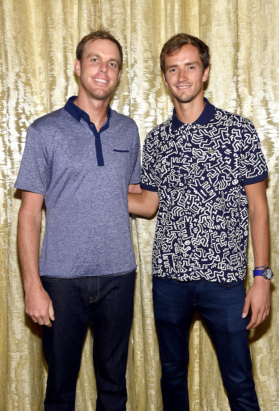 American tennis star Querrey posed for a photo with Russia's Medvedev.