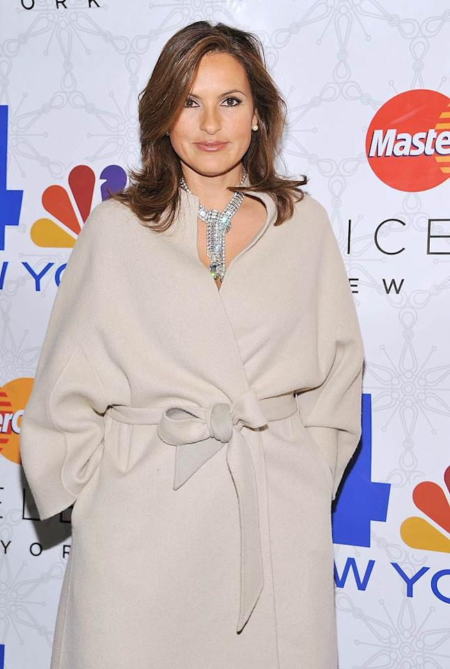 """Law and Order"" actress Mariska Hargitay struck a pose in her trendy trench coat on the red carpet. (11/30/2011)"