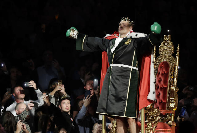 Tyson Fury, of England, arrives in the arena before a WBC heavyweight championship boxing match against Deontay Wilder, Saturday, Feb. 22, 2020, in Las Vegas. (AP Photo/Isaac Brekken)