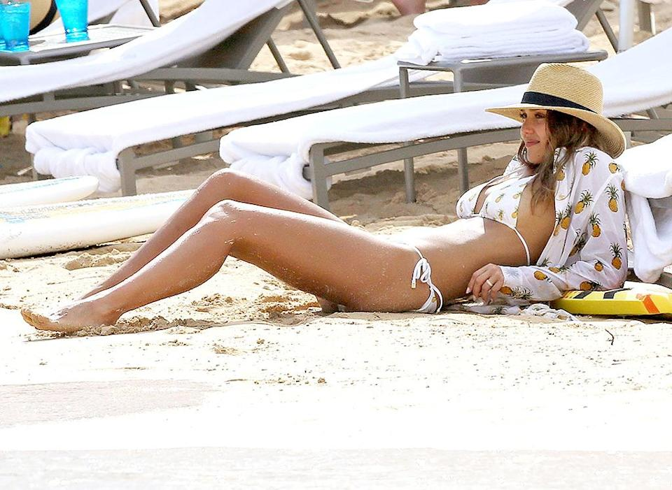 <p>The actress and businesswoman, seen here in Hawaii, was a tropical delight in a pineapple bikini. (Photo: AKM-GSI) </p>