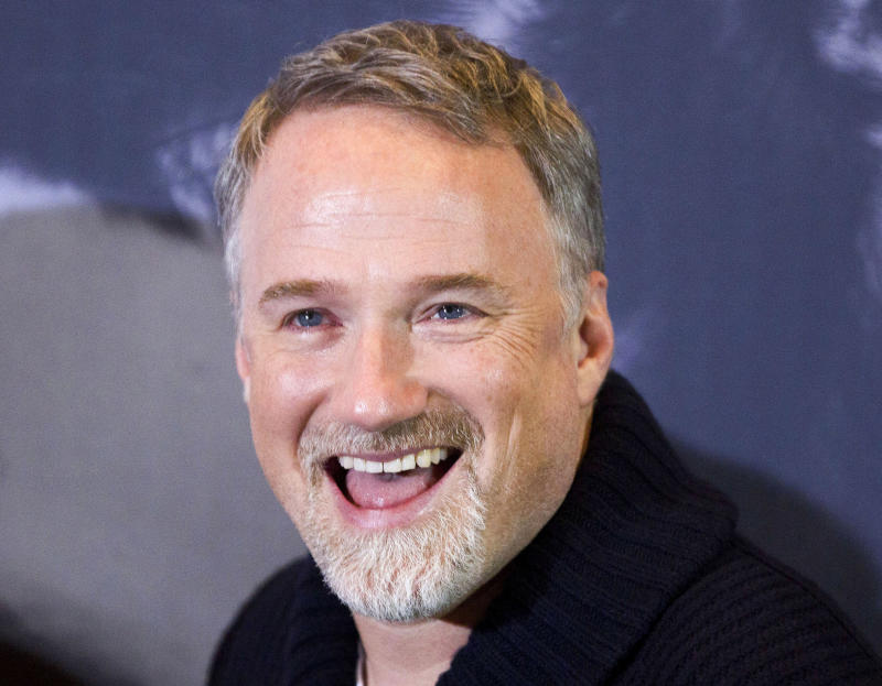 "In this photo taken Jan. 5, 2012, U.S. director David Fincher smiles during a photo call for the movie ""The Girl with the Dragon Tattoo""in Berlin, Germany. The Walt Disney Studios will film a new version of ""20,000 Leagues Under the Sea"" in Australia after the country agreed to pay it 21.6 million Australia dollars ($22.6 million) to film the movie there. The inducement announced Tuesday, April 2, 2013, is the biggest ever paid by an Australian government to bring in a Hollywood production. Fincher will direct the Jules Verne science fiction classic, said Disney Asia-Pacific spokeswoman Alannah Hall-Smith. (AP Photo/Gero Breloer)"