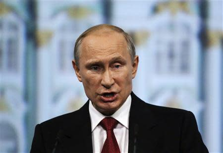 Russia's President Vladimir Putin delivers a speech during a session of the St. Petersburg International Economic Forum 2014 (SPIEF 2014) in St. Petersburg