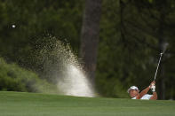 Hideki Matsuyama, of Japan, hits out of a bunker on the first hole during the third round of the Masters golf tournament on Saturday, April 10, 2021, in Augusta, Ga. (AP Photo/Matt Slocum)