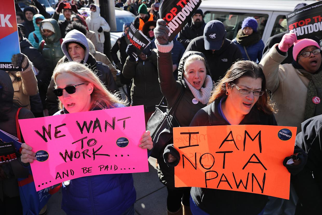 Hundreds of federal workers and contractors rally against the partial federal government shutdown outside AFL-CIO headquarters in Washington, D.C. (Photo: Chip Somodevilla/Getty Images)