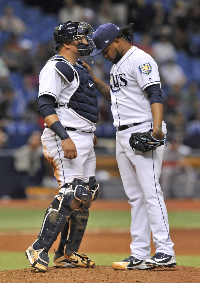 Tampa Bay Rays catcher Jesus Sucre, left, talks with closer Alex Colome on the mound after the Boston Red Sox scored the go-ahead run during the ninth inning of a baseball game Wednesday, May 23, 2018, in St. Petersburg, Fla. (AP Photo/Steve Nesius)