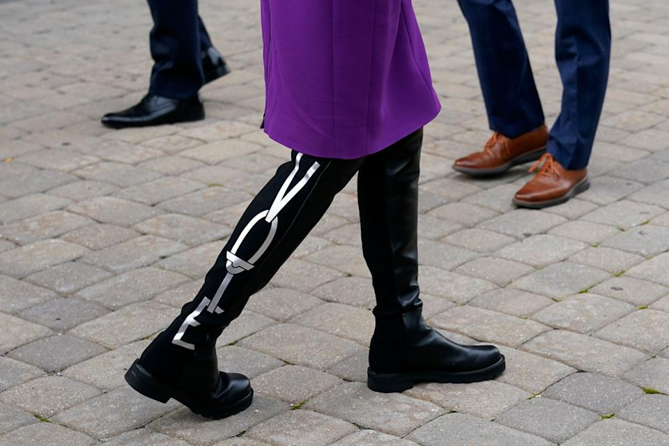 """Jill Biden wears boots bearing the word """"Vote"""" as she and her husband, Democratic presidential nominee Joe Biden, depart after voting early in Delaware's state primary election on Sept. 14, 2020. (Photo: ASSOCIATED PRESS)"""