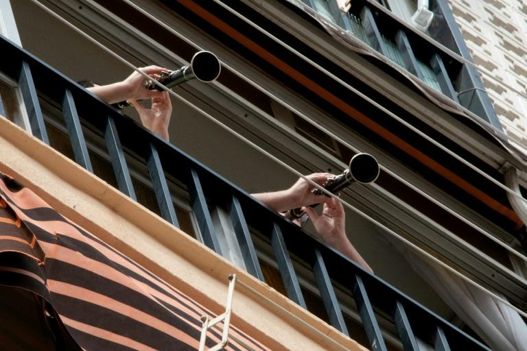 In Spain people play music from their balconies after strict lockdown measures were brought in to battle the spread of the coronavirus