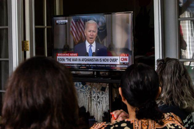 Military families and veterans watch President Joe Biden's speech announcing that all troops are out of Afghanistan on Aug. 31, 2021, in Long Beach, California. (Photo: APU GOMES via Getty Images)