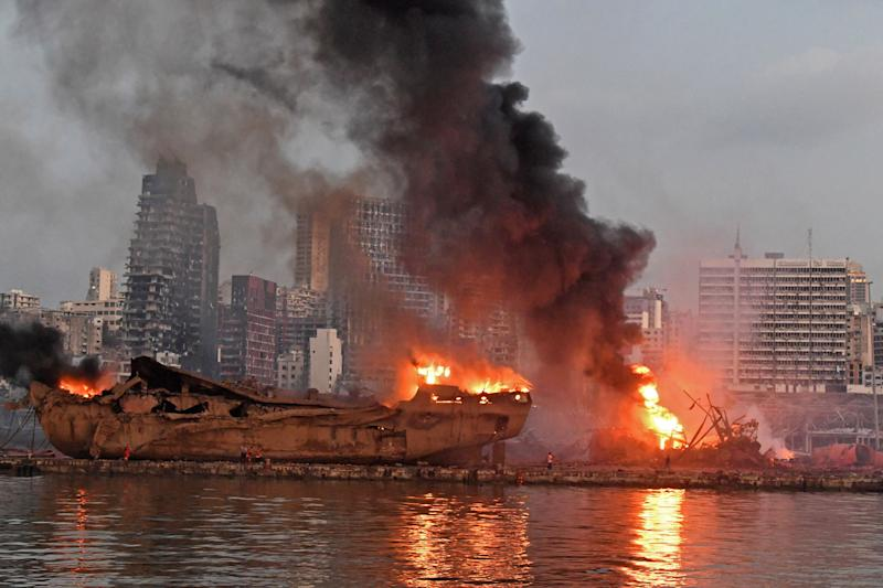 A ship is pictured engulfed in flames at the port of Beirut following a massive explosion that hit the heart of the Lebanese capital on August 4, 2020. - Rescuers searched for survivors in Beirut on August 5 after a cataclysmic explosion at the port sowed devastation across entire neighbourhoods, killing more than 100 people, wounding thousands and plunging Lebanon deeper into crisis. (Photo by - / AFP) (Photo by -/AFP via Getty Images)