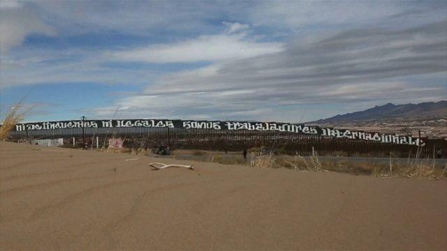 Mexican activist paint giant border wall message