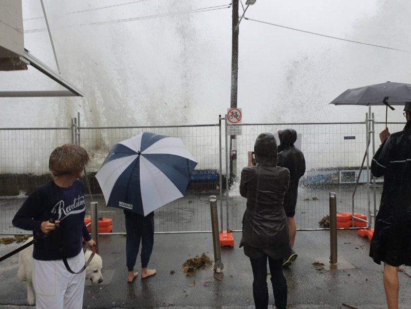 Pictured is the waves crashing on Manly's Fairy Bower, with the waves coming on to the footpath. Source: Twitter/@DocHarleyMD