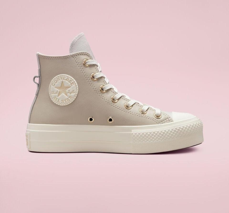 """<p><span>Earthy Tones Platform Chuck Taylor All Star</span> ($75)</p> <p>""""The soft beige shade of these sneakers if perfect for fall. I'll wear them with jeans as well as midi dresses."""" - Macy Cate Williams, senior editor, Shop</p>"""