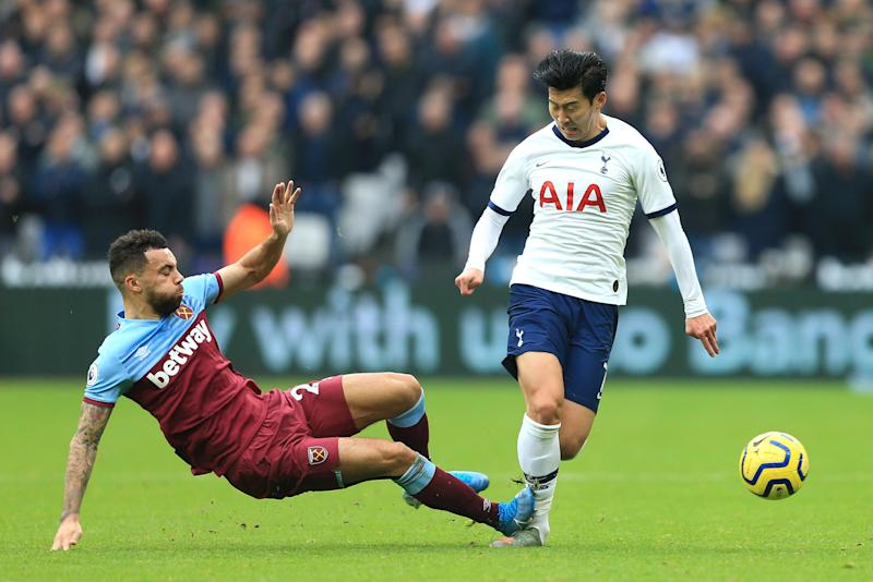 LONDON, ENGLAND - NOVEMBER 23: Ryan Fredericks of West Ham United fouls Heung-Min Son of Tottenham Hotspur and receives a yellow card during the Premier League match between West Ham United and Tottenham Hotspur at London Stadium on November 23, 2019 in London, United Kingdom. (Photo by Stephen Pond/Getty Images)