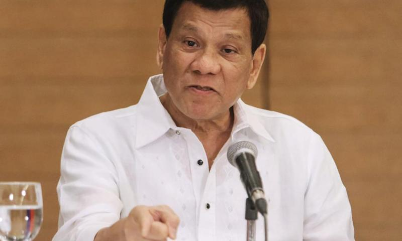 Philippine President Rodrigo Duterte gestures as he speaks during a press conference in Davao City.